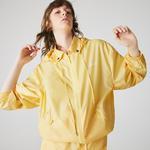 Lacoste L!VE Kadın Kapüşonlu Katlanabilir Sarı Yağmurluk